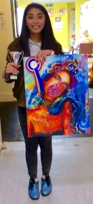 Krizzler Cree with her painting which won best young person's entry and the Barbara Hannam Trophy
